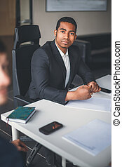 peaceful african american businessman in modern office
