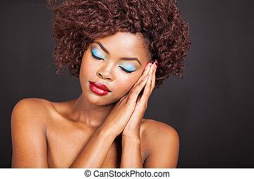 african american woman sleeping on hands