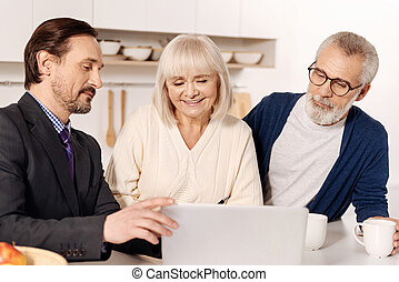 Peaceful agent presenting plan of the house to future owners