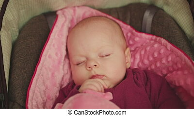 Peaceful Baby Sleeping in a Car Seat