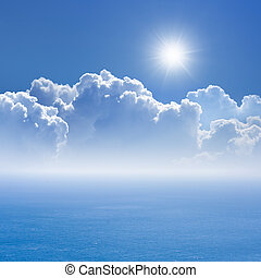 Peaceful background - blue sea and sky, white clouds, bright sun - heaven