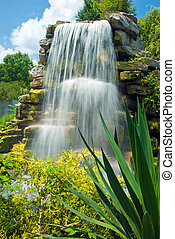 Peaceful beautiful waterfall in jun