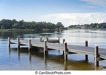 Peaceful Dawn on Florida Bayou - Fishing pier and boat...