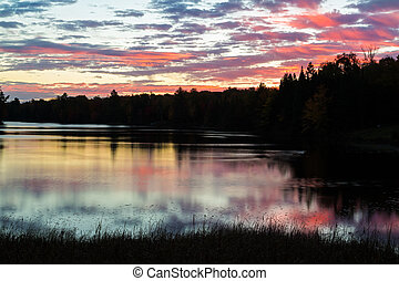 Peaceful Daybreak - Vibrant colors of a cloudy, pre-dawn sky...