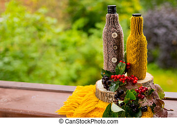 Peaceful Fall berries, Leaf, Acorn, scarf as Still Life on Rustic Wooden Cut Tree Trunk and nature Background. Copy Space for Text, Your Words. Autumn mood, postcard.knitting, crocheting concept