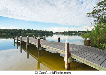 Peaceful Fishing Pier on Bayou - Fishing pier and boat...