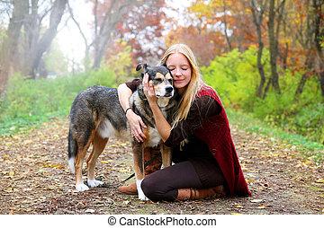 Peaceful Happy Woman Hugging German Shepherd Dog While...