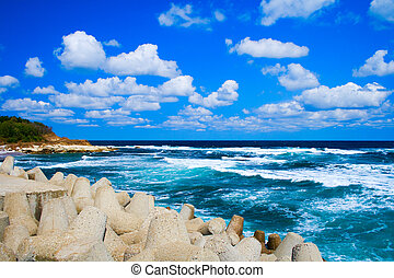 Peaceful idyllic seascape - turquoise sea and blue cloudy...