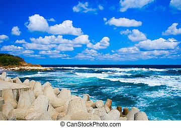 Peaceful idyllic seascape - turquoise sea and blue cloudy...