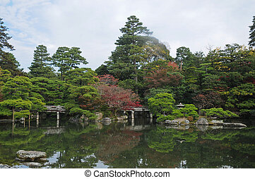 Peaceful Japanese zen garden and pond in Autumn