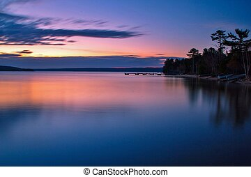 Sunrise reflections along the shores of a calm Lake Superior.