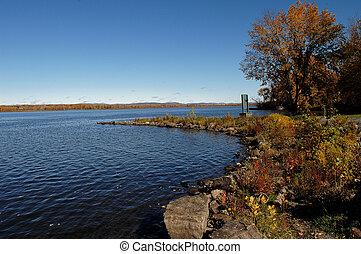 Peaceful lake under blue sky.