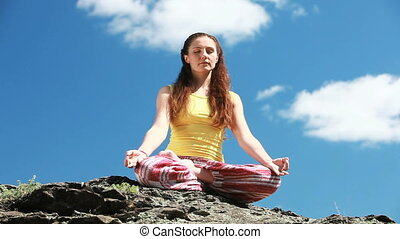 Peaceful lotus - Peaceful girl sitting in lotus pose in the...