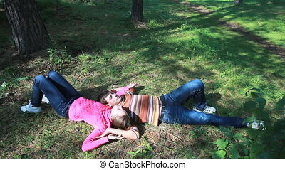 Peaceful mood - Cute couple lying on the ground in a summer...