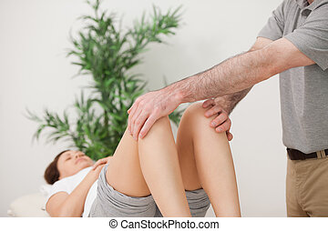 Peaceful patient lying with her legs bent