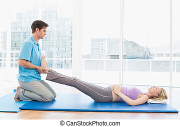 Peaceful pregnant woman getting a relaxing massage