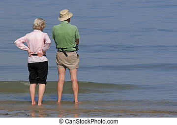 Peaceful Retirement - Elderly man and woman standing...