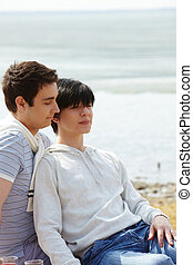 Peaceful sweethearts - Vertical image of two gay boys...