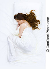 Peaceful time - Serene woman covered with silk cloth lying...