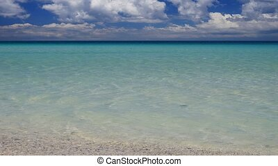 Peaceful tropical sescape camera tilt up - Camera tilt up of...