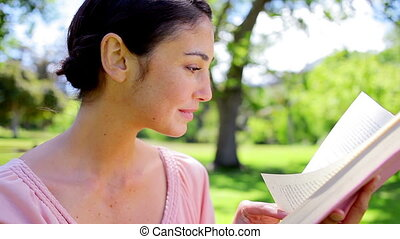 Peaceful woman reading a book