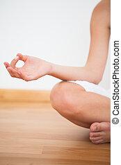 Peaceful woman sitting in lotus pose