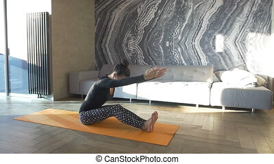 Peaceful yoga. Happy and beautiful woman doing exercise of yoga at home.