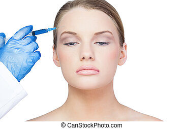 Peaceful young model having botox injection