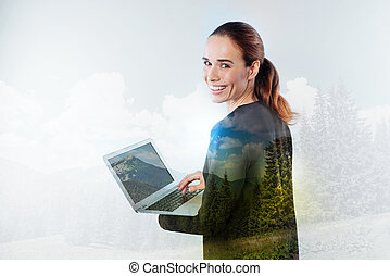 Peaceful young woman with a new laptop