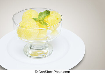 peach and melon sorbet in salad bowl on a white plate