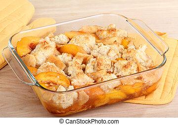 Peach Cobbler - Peach cobbler dessert in a baking dish