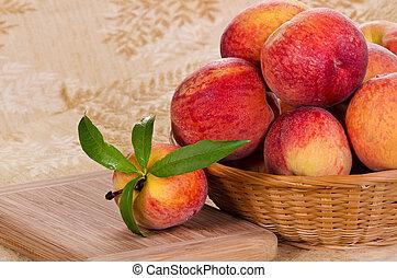 Peach fruits in basket