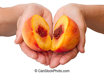 Peach halves in his hands isolated on white background