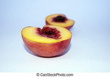 Peach halves. isolated. Shallow Depth of Field