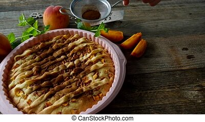 Peach homemade pie on a wooden table