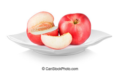 Peach in plate on white background