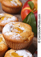 peach muffins with icing sugar closeup on the table