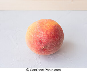 peach on a wooden table