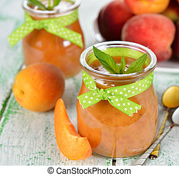 peach puree in a glass jar on a white table