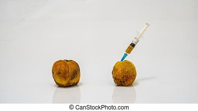 Peach rotting time lapse, the concept of plant ginetic modification, medical rejuvenation of the body, various cosmetic procedures.