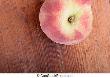 peach set on the wooden background