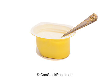 Peach yoghurt in open plastic cup with spoon isolated on white