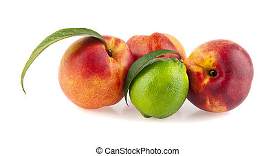 peaches and lime isolated on white background
