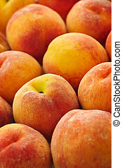Peaches background - Ripe fresh peaches as background close...