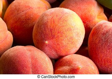 Close up view of fresh ripe peaches