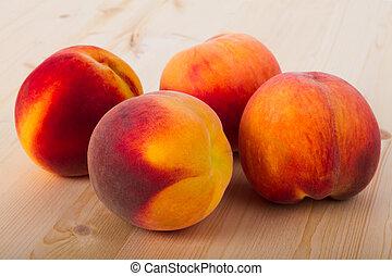 Peaches  - Fresh peaches on a light wood background
