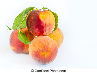 peaches fruits with red sides in a slide on a light background, close-up