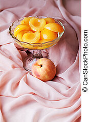peaches in syrup and glass vase