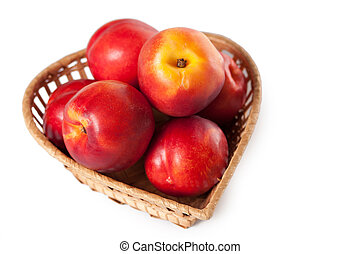 peaches on a white background in the basket