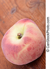peaches on the wooden background